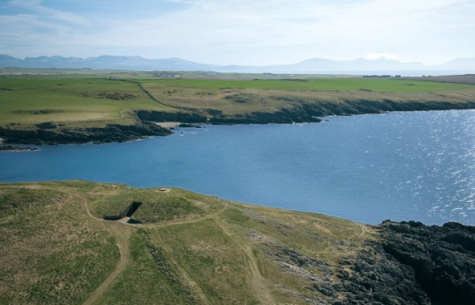 Aerial view Barclodiad y Gawres . Image: CADW ( Crown Copyright) C(CD35)